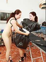 Two nurses in transparent latex kinky dildo games in rubber clinic operating room
