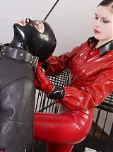 Slave girl was put into leather strait jacket and the leather leg-sack