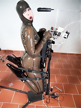 Slavegirl in tight latex bounded to electro stim