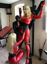 Rubberdolls dressed up in red latexsuits get trained with dildos and had their own plesure together