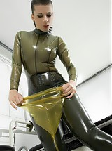 Freaky girl dressed transparent rubberclothes and piss panties, was going to fill it so much, that the piss was running down at the side